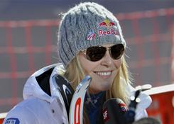 Lindsey Vonn of the U.S, seen here Thursday talking to reporters, will wait until just before the start of the downhill race before she decides if she can defend her title.
