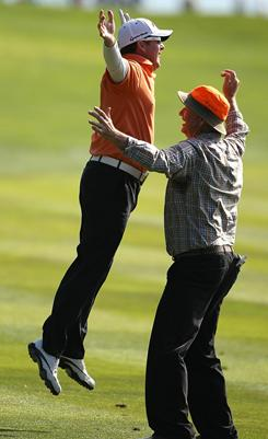 D.A. Points celebrates with actor Bill Murray on Sunday after holing out for eagle on the 14th hole during the final round of the AT&T Pebble Beach National Pro-Am.