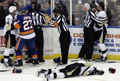 Pittsburgh's Eric Tangradi lies on the ice Friday after being hit by the New York Islanders' Trevor Gillies, who received a nine-game suspension.