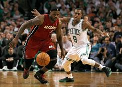 LeBron James of the Miami Heat battles Rajon Rondo of the Boston Celtics for control of the ball at TD Garden on Sunday.