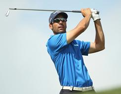 Alvaro Quiros of Spain fires a second consecutive 68 on Sunday to win the Omega Dubai Desert Classic at the Emirates Golf Club in Dubai.