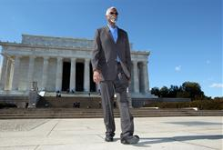 "Bill Russell walks in front of the Lincoln Memorial, where he witnessed Martin Luther King's ""I Have a Dream"" speech in 1963. Tuesday he will receive the nation's highest civilian honor."