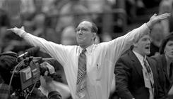 Dan Gable, shown in this 1996 photo, celebrates one of the many Iowa wrestling victories he coached in his 21 seasons at the school.
