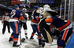 The New York Islanders and the Pittsburgh Penguins mix it up during the second period last Friday.