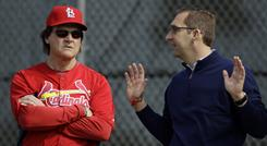Cardinals manager Tony La Russa, left, and general manager John Mozeliak talk during spring training.