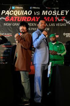Manny Pacquiao, left, and Shane Mosley pose to promote their May 7 fight.