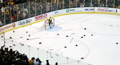 The ice was littered with gloves and sticks after a recent fight-filled game between the Boston Bruins and Montreal Canadiens.