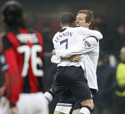 Tottenham forward Peter Crouch celebrates his goal against AC Milan with teammate Aaron Lennon.