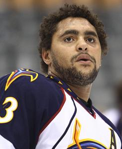 Dustin Byfuglien was one of five players that the Thrashers acquired from the champion Blackhawks.