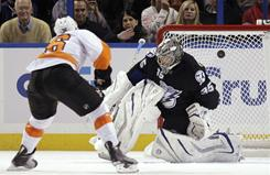 The Flyers' Darroll Powe scores on a penalty shot against Lightning goalie Dwayne Roloson during the second period of their game in Tampa. Philadelphia won 4-3 in a shootout.