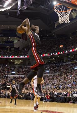 The Heat's LeBron James goes up for a dunk against the Toronto Raptors during the second half of their game on Wednesday night in Toronto.