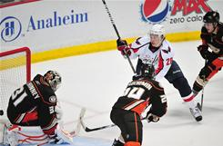 The Capitals' Alexander Semin (28) scores his third goal of the game against Ducks goalie Curtis McElhinney, left, during the third period. Washington defeated Anaheim 7-6.
