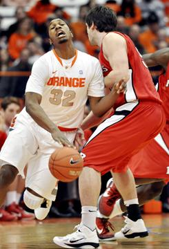 Syracuse's Kris Joseph (32) scored 21 points in a 84-80 win over Rutgers in Syracuse, N.Y.