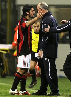 AC Milan's Gennaro Gattuso exchanged words with Tottenham assistant Joe Jordan during the game before head-butting Jordan after the final whistle.