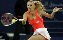 Caroline Wozniacki of Denmark lines up a forehand during her match Wednesday against Anna Chakvetadze of Russia at the Dubai Tennis Championships. Wozniacki advanced when Chakvetadze had to retire after collapsing on the court.