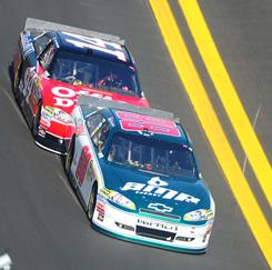 Dale Earnhardt Jr. leads Tony Stewart during the second Gatorade Duel at Daytona International Speedway on Thursday.