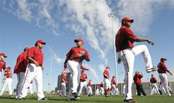 Arizona Diamondbacks players warm-up during spring training near Scottsdale, Arizona. The Diamondbacks jettisoned third baseman Mark Reynolds in the offseason in an attempt to cut down on their strikeouts; they led the majors in that category last year.