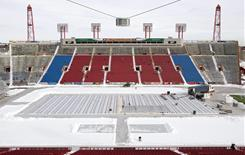 Crews at McMahon Stadium in Calgary, clear snow in preparation for the NHL Heritage Classic outdoor hockey game. The Calgary Flames are scheduled to host the Montreal Canadiens on Feb. 20.