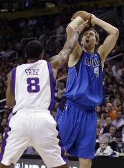 Dirk Nowitzki shoots over the Suns Channing Frye. Nowitzki had 35 points in both teams' final game before the All-Star break; Frye led the Suns with 24 points.