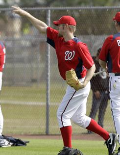 Nationals pitcher Stephen Strasburg practices for the first time since Tommy John elbow surgery last year.