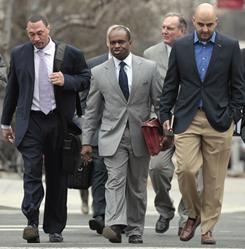 NFLPA chief DeMaurice Smith is flanked by Steelers backup quarterback Charlie Batch, left, and NFLPA spokesman George Atallah as they arrive for the opening mediation session.