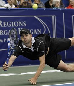 Andy Roddick tumbles as he reaches for a forehand during his 4-6, 6-3, 6-4 victory against Lleyton Hewitt of Australia in the quarterfinals of the Regions Morgan Keegan Championships on Friday in Memphis.