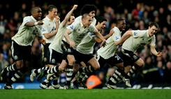 Everton players celebrate after their captain Phil Neville scores on his penalty kick to clinch their 4-3 win over Chelsea in the FA Cup.