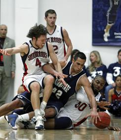 St. Mary's Matttew Dellavedova, left, Utah State's Tai Wesley, center, and St. Mary's Kenton Walker III fight for a loose ball during their game in Morgana, Calif.