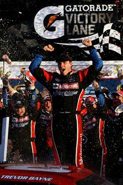 Trevor Bayne celebrates in victory lane after winning the Daytona 500 on Sunday. Bayne, 20, took advantage of two late caution flags, to steer his way past the field.