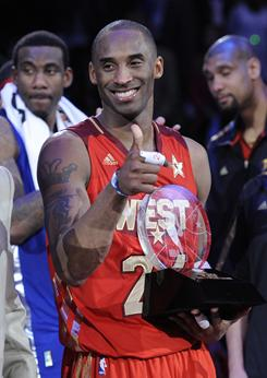 Kobe Bryant gives a thumbs up to the Staples Center crowd after being presented with the All-Star Game MVP trophy.