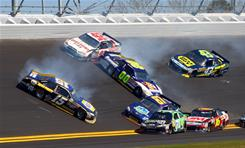 "Michael Waltrip (15), triggered a 14-car pile-up that included David Reutimann (00), Joe Nemechek (87) and Greg Biffle (16). ""It's just a product of this type of racing,"" said Reutimann, who finished 30th."