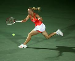 Caroline Wozniacki of Denmark chases down a forehand during her 6-1, 6-3 victory against Svetlana Kuznetsova of Russia in the final of the Dubai Tennis Championship on Sunday.