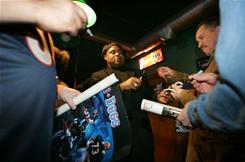 Dave Duerson, signing autographs in 2005, was a member of the Super Bowl XX champion Chicago Bears. His body was found Feb. 17 in his Sunny Isles Beach, Fla., home, and his death was ruled a suicide.