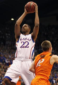 Marcus Morris scored 27 points, including three threes, to help the Kansas Jawhawks soar past Oklahoma State.