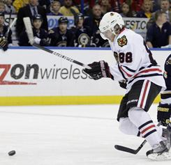 Patrick Kane notched a goal and an assist as the Blackhawks used a four-goal second period to down the Blues.