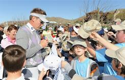 Ian Poulter of England signs autographs for fans Tuesday after the announcement of the oufit he will wear during the first round of the World Golf Championships-Accenture Match Play Championship beginning Wednesday at The Ritz-Carlton Golf Club, Dove Mountain, in Marana, Ariz.