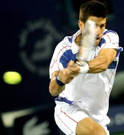 Novak Djokovic of Serbia powers a backhand during his victory Wednesday against Feliciano Lopez of Spain at the Dubai Duty Free Tennis Championships.