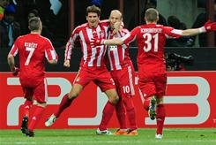 Bayern Munich teammates mob Mario Gomez, second from left, after his game-winning goal against Inter Milan.