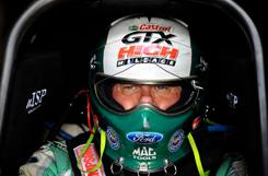 John Force, seen here in his cockpit during testing at Arizona's Firebird Raceway in 2010, remains a force in Funny Car racing even at 61.
