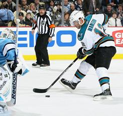 Patrick Marleau, right, scored twice, including the game-winner in overtime, to help the Sharks extend their winning streak to five.
