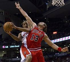 The Raptors' DeMar DeRozan, left, is fouled by Bulls center Joakim Noah during the first half of their game Wednesday night. DeRozan had 24 points to help Toronto spoil Noah's first game back with Chicago following an injury.