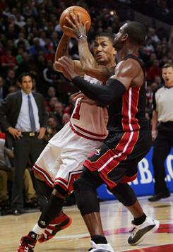 Dwyane Wade and LeBron James got theirs, but Derrick Rose's 26 points led the Bulls to victory over the Heat in Chicago.