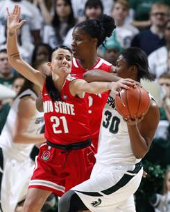 Ohio State's Samantha Prahalis, left, pressures Michigan State's Lykendra Johnson during the first half of their game Thursday night in East Lansing, Mich.