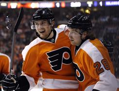 James van Riemsdyk, left, and Claude Giroux celebrate a second-period goal as the Philadelphia Flyers continued their recent dominance of the New York Islanders.