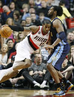 Portland Trail Blazers forward LaMarcus Aldridge drives to the basket as Denver's Nene defends during Portland's 107-106 overtime victory.