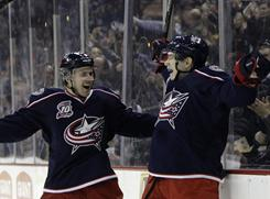 Rookie Matt Calvert, right, had his first career hat trick to help the Blue Jackets stay alive in the playoff hunt.