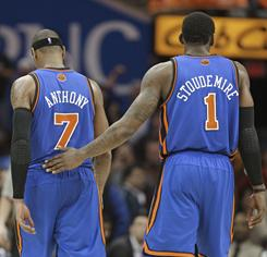 New York forward Amar'e Stoudemire pats Carmelo Anthony on the back after Anthony fouled out of their 115-109 loss to the Cavaliers.