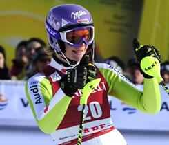 Germany's Maria Riesch celebrates at the finish area after winning on Friday.