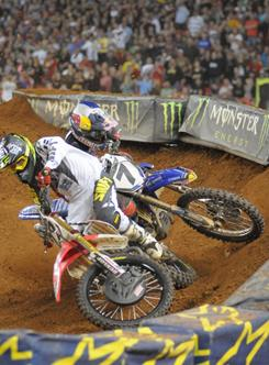 Chad Reed (left) and James Stewart collide while racing for the lead on the last lap of Saturday's Supercross event at the Georgia Dome in Atlanta.