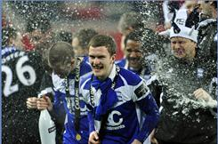 Birmingham City celebrates their 2-1 Carling Cup final victory over Arsenal.  Birmingham won its first trophy in 48 years; Arsenal has not brought home any hardware since the 2005 FA Cup.